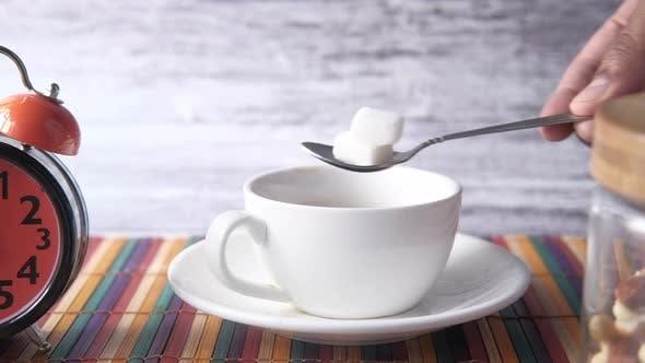 Tasse Tee Zucker Cube Tisch