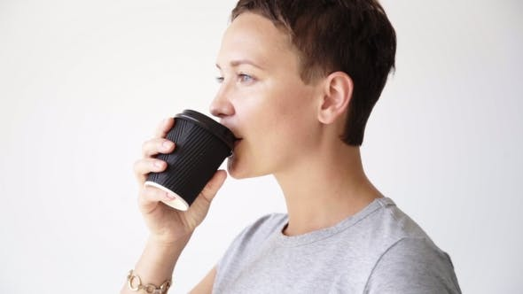 Woman With Take Away Cup