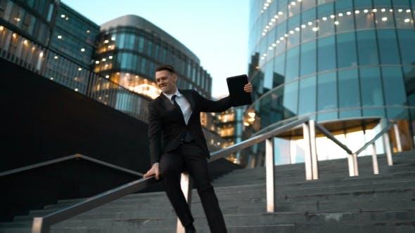Thumbnail for Businessman Slide The Rail