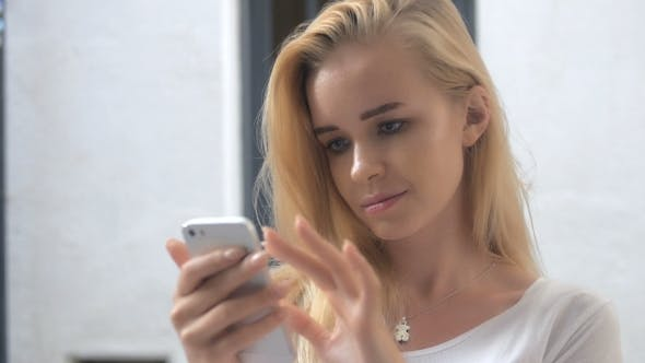Thumbnail for Summer Lifestyle Portrait Of Beautiful Girl Holding In Hand Smart Phone. Enjoying Life And Smiling