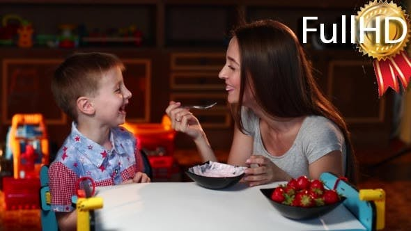 Thumbnail for Mother Feeds the Son With a Spoon