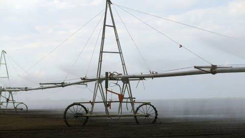 Center Pivot With Drop Sprinklers In a Field