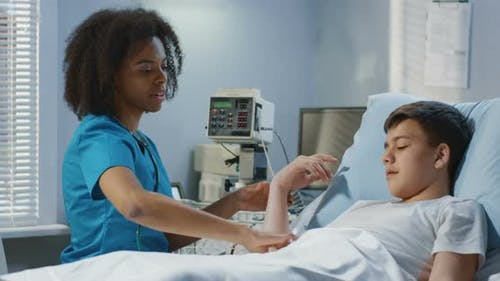 Female Doctor Visiting Teenager Patient