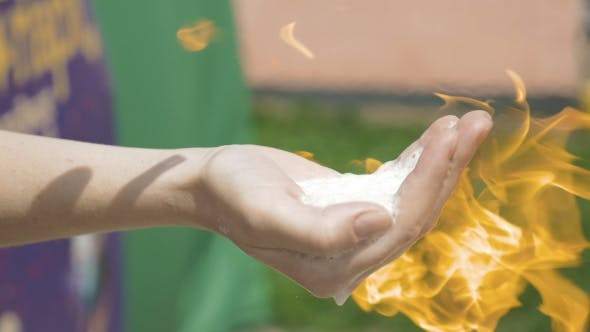 Cover Image for A Hand With Flammable Substance Is Set On Fire