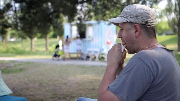 Thumbnail for A Man Eating a Hamburger