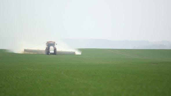 Thumbnail for Farmer Is Fertilize Corn Field. Farming Background.