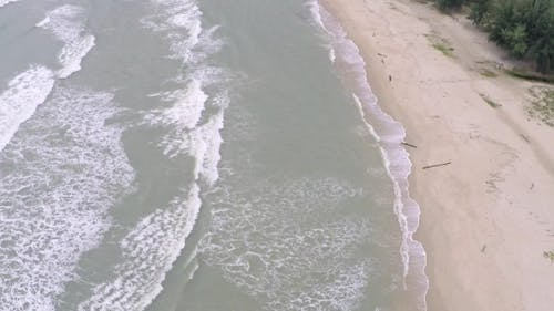Aerial  Video Of Sea Surf And Sandy Beach