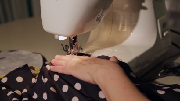 Tailor Behind a Sewing Machine