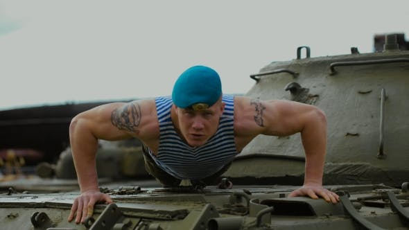Thumbnail for A Soldier In a Blue Beret Doing Push-ups.