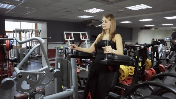 Thumbnail for A Woman Performs an Exercise on Pumping up Press on Simulator