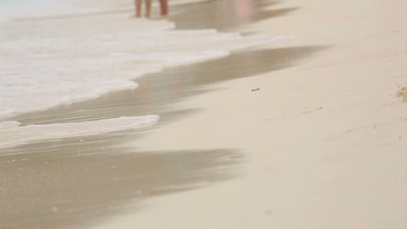 Thumbnail for Tourists Walk On The Beach