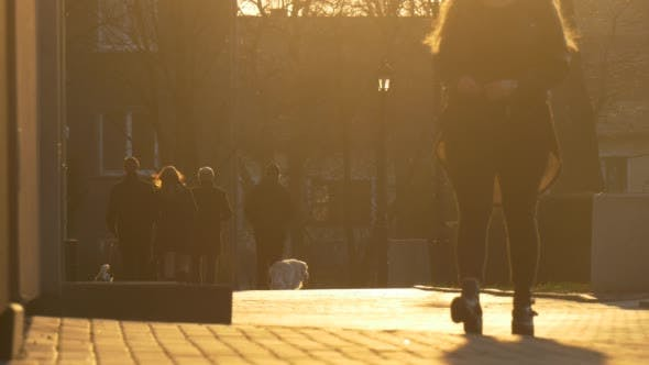 Thumbnail for Silhouettes of a People in Sun Rays Walking City