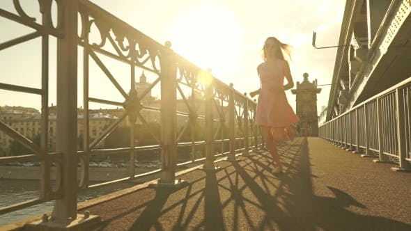 Thumbnail for Beautiful Girl in Pink Dress Runs on the Bridge