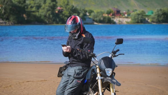 Thumbnail for Biker On The Bank Of The River