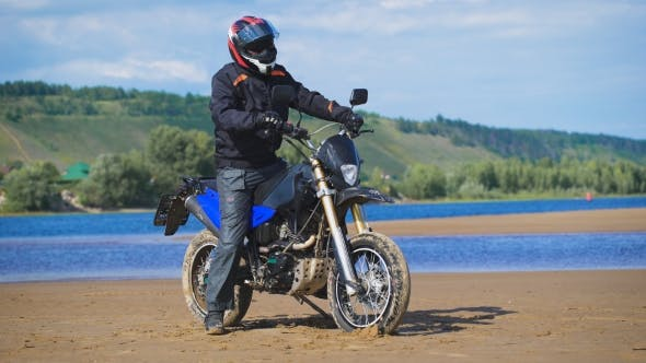 Thumbnail for In The Frame Of The Rider In Full Gear With His Bike