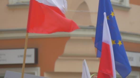 Thumbnail for Activists Are Waving Polish Flag Blue EU Flag