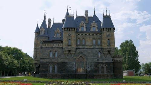Facade Of Castle And Royalty Garden