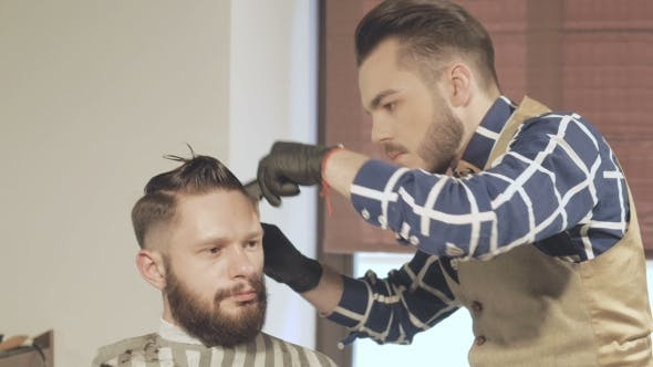 Men's Hairstyling And Haircutting With Hair Clipper In a Barber Shop Or Hair Salon
