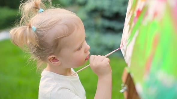Thumbnail for Little Girl Draws On An Easel