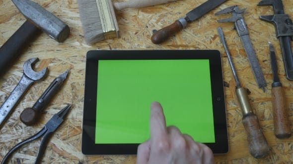 Thumbnail for Male Hand Of Artisan Craftsman Using Tablet Pc With Green Screen In Workshop.
