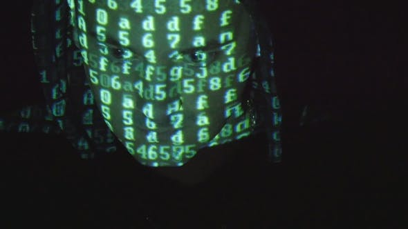 Thumbnail for Male Face Of Hacker With Binary Code Projections.