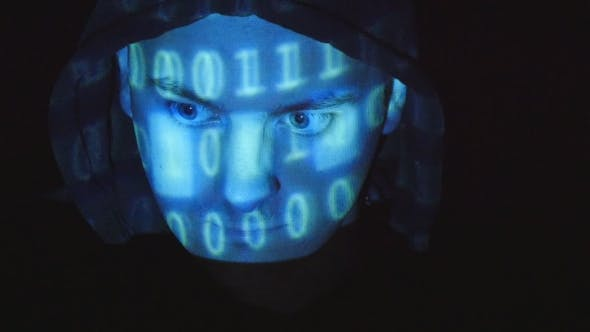 Thumbnail for Source Code Projected Over An Angry Hostile Man's Face, Black Background.