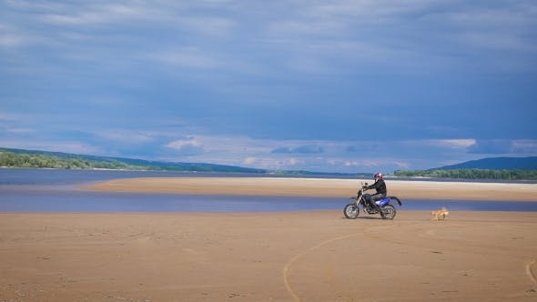 Thumbnail for The Feeling Of Freedom And Moto Aesthetics. Motorcyclist Riding On His Bike On Sandy Beach.