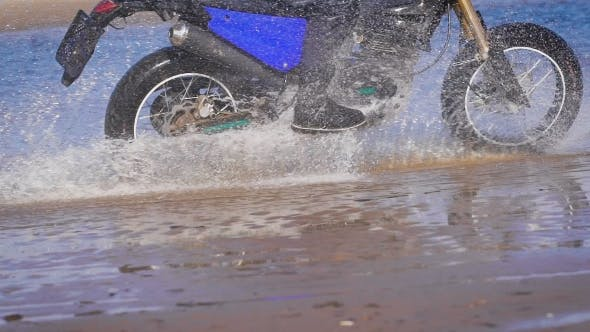 Thumbnail for Extreme Driving a Motorcycle. A Skilled Biker Riding On The Edge Of Water