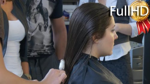 Stylist Hairdresser is Combing Hairs Making a
