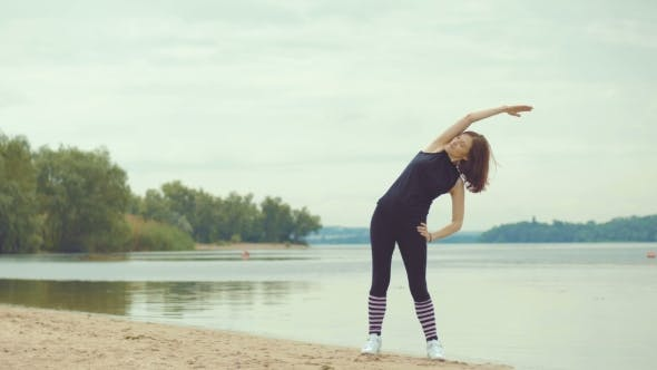 Cover Image for Beautiful Red-haired Girl Doing Exercises