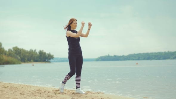 Beautiful Red-haired Girl Doing Exercises