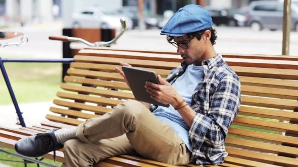 Thumbnail for Man With Tablet Pc Sitting On City Street Bench 27