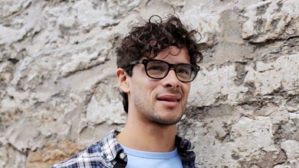 Thumbnail for Smiling Man In Eyeglasses Over Street Wall 20