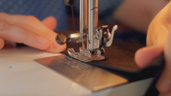 Thumbnail for Sewing Machine is Stitching Black Fabric