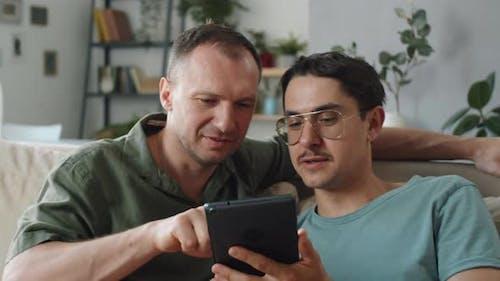 LGBTQ Couple At Home