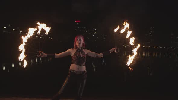 Thumbnail for Artist Creating Fire Circle Spinning Fans at Dusk
