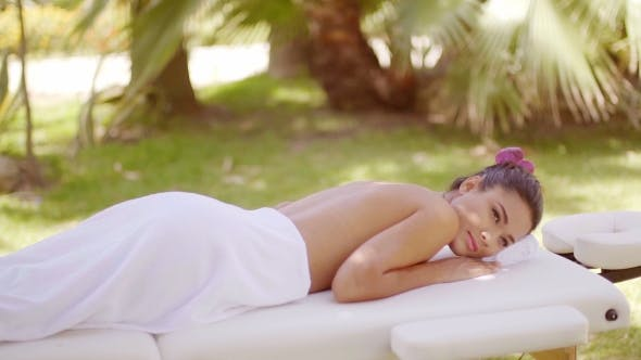 Thumbnail for Young Woman On Vacation Enjoying a Spa Treatment