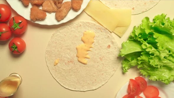 Thumbnail for Girl Cooking Caesar Roll With Flatbread