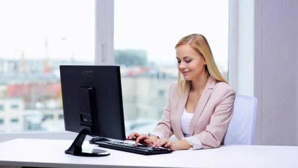 Thumbnail for Young Businesswoman With Computer Typing At Office 5