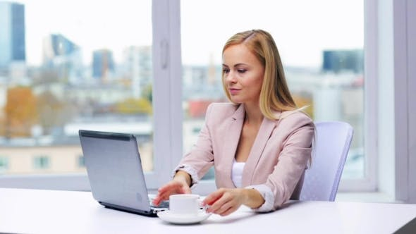 Thumbnail for Businesswoman With Laptop And Coffee At Office 31