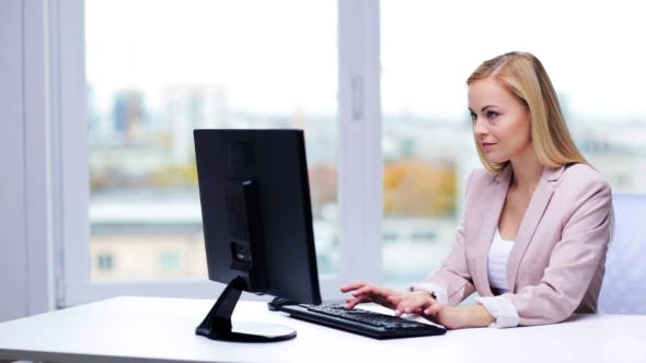Thumbnail for Young Businesswoman With Computer Typing At Office 3