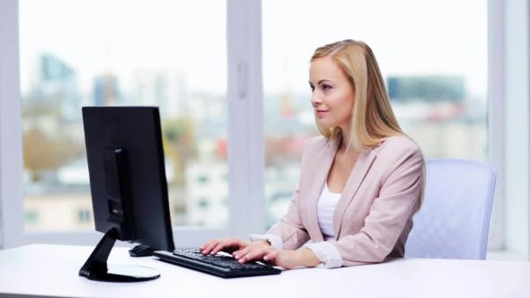 Thumbnail for Young Businesswoman With Computer Typing At Office 1