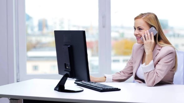 Thumbnail for Smiling Businesswoman With Computer And Smartphone 13