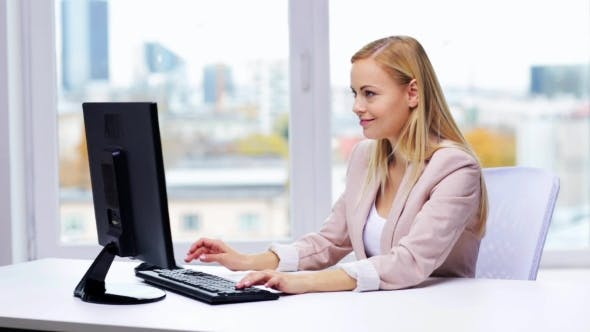 Thumbnail for Happy Businesswoman With Computer Typing At Office 20