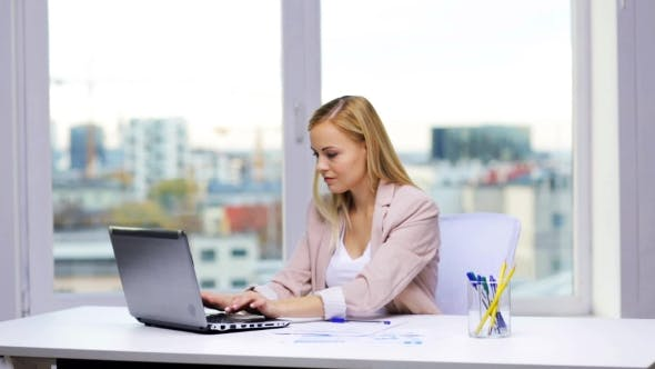 Thumbnail for Smiling Businesswoman With Laptop And Papers 47