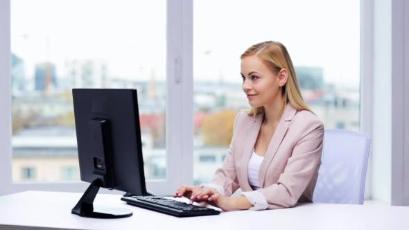Thumbnail for Young Businesswoman With Computer Typing At Office 6