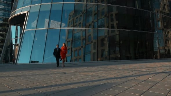 Thumbnail for Couple Of Business People Walking Near Business Centre