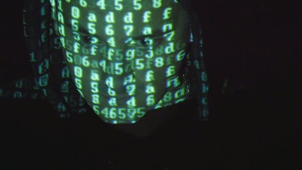 Thumbnail for Male Face of Hacker With Binary Code Projections. Source Code Projected Over an Angry