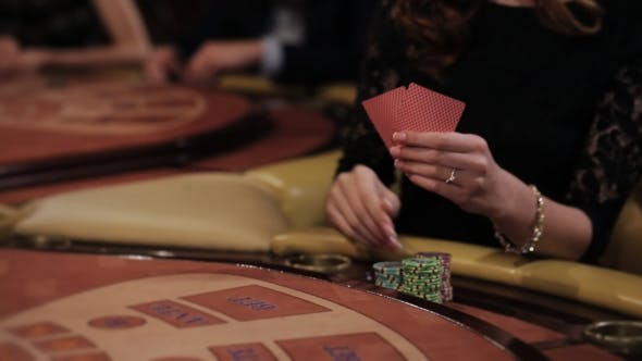 Thumbnail for Beautiful Women Playing At The Table Blackjack In a Casino