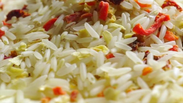 Thumbnail for Rotating Heap Of Uncooked Rice And Vegetables